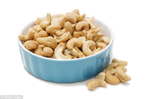 Vitamin C boosts absorption of iron from non-meat sources, so eat cashews with a kiwi fruit