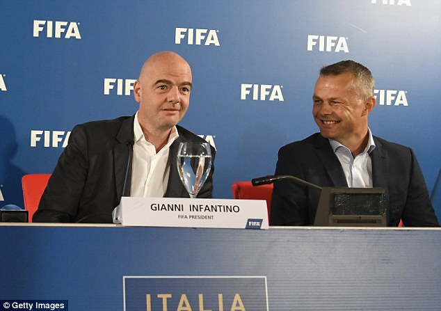 Infantino sits with referee Bjorn Kuipers, who used the technology during the game
