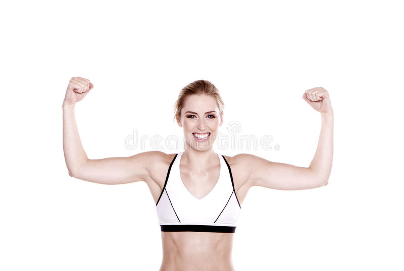 Fitness woman. Beautiful blond fitness woman showing off her arms stock photo