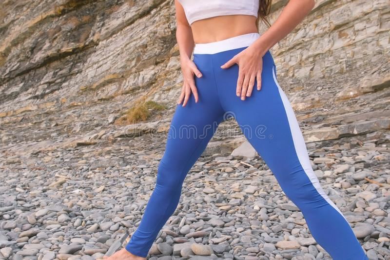 Flat belly girl during breathing exercises bodyflex. Belly close-up view. Flat belly girl during breathing exercises body flex stock images