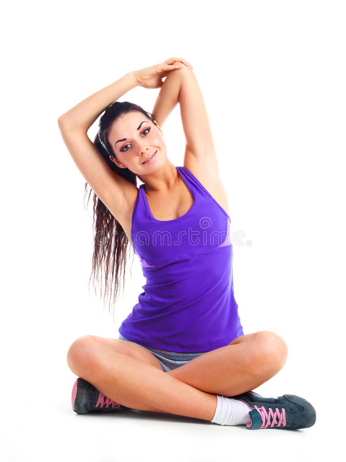 Girl stretching. Beautiful young brunette woman stretching the muscles of her arms stock image