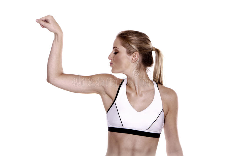 Showing off. Beautiful blond woman showing off her arms stock photos