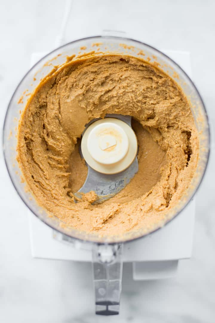 Overhead image of Honey Roasted Peanut Butter as it is blended in the food processor.